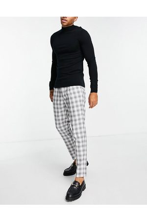 Topman Tapered checked trousers in black and white