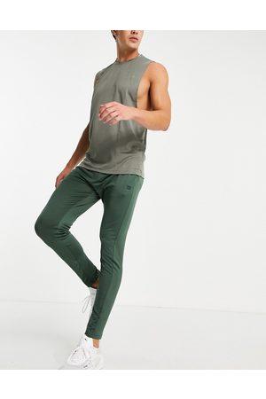 Threadbare Fitness Threadbare Active super skinny training joggers in khaki-Green