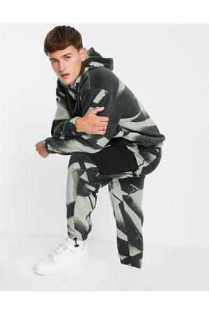 ASOS Co-ord polar fleece oversized joggers in all camo over print-Multi