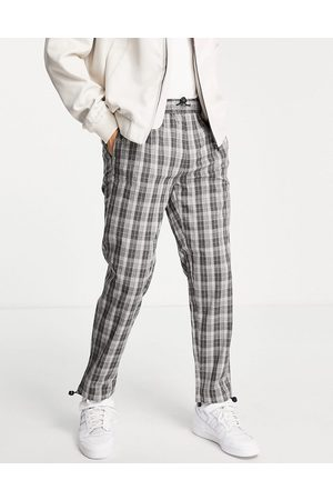 Topman Herren Chinos - Relaxed check trousers in navy with bungee cord