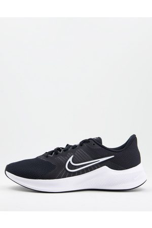Nike Running Downshifter 11 trainer in black and white